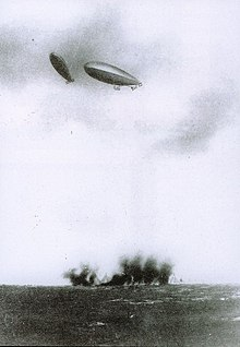 Italian dirigibles bomb Turkish positions on Libyan Territory. The Italo-Turkish War of 1911-1912 was the first in history in which air attacks (carried out here by dirigible airships) determined the outcome.