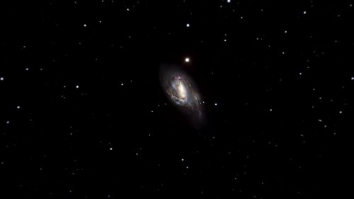 File:Zooming in on Messier 66 galaxy.ogv