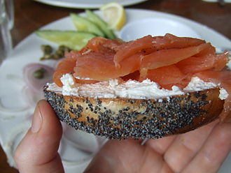 "Bagel - Bagels with cream cheese and lox (cured salmon) are considered a traditional part of American Jewish cuisine (colloquially known as ""lox and a schmear"")."