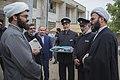 اهداء پرچم حرم علی بن موسی الرضا به هیئت ها یا موکب های مستقر در شهر مهران در ایام پیاده روی اربعین 23.jpg