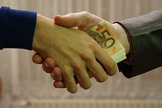 Bribery - Giving money to influence a person's behavior is a form of bribery.