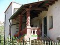 122 Xalet de Montserrat, barri del Balneari (Vallfogona de Riucorb), façana oest, porxo.jpg