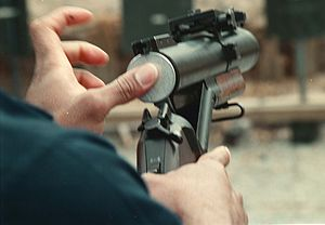 United States 40 mm grenades - A less-lethal 40×46mm round is loaded into a M79 Grenade launcher