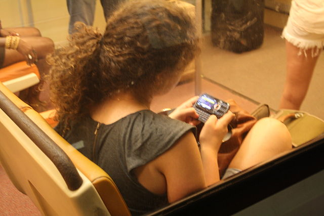Looking at smartphone on subway