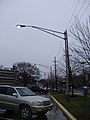 2014-12-20 15 47 07 Mercury vapor street lights active during the day at the New Jersey Department of Transportation Headquarters along Parkway Avenue (Mercer County Route 634) in Ewing, New Jersey.JPG