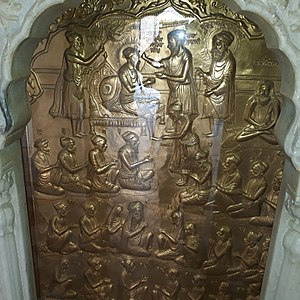 Guru Amar Das - Brass plaque at Gurdwara Chaubara Sahib Goindwal depicting scene of guru ramdas being enthroned to Guruship where all 22 manji heads were in presence