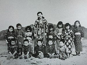 Twenty-Four Eyes - Photograph taken within the film of teacher Hisako Ōishi and her twelve first-grade students.