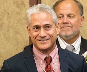 Greg Louganis - Louganis in 2016 at an event celebrating the 25th anniversary for the passage of the Ryan White CARE Act, which improved the quality and availability of healthcare for individuals and families with HIV/AIDS