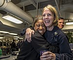3rd Class, left, congratulates 1st Class Beth Lewis upon being selected for chief petty officer. (35617038533).jpg
