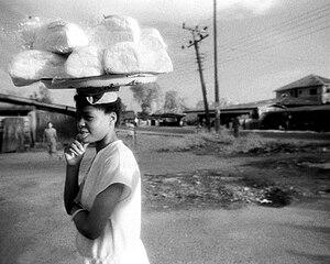 Women in Nigeria - A Nigerian woman balancing market goods on her head