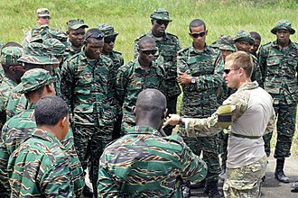 Foreign internal defense - U.S. Army Special Forces soldier instructing Guyana Defence Force soldiers on air assault techniques.
