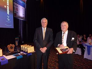 Australasian Hydrographic Society - AHS Patron, Vice Admiral Chris Ritchie AO RANR (left) presenting award at Hydro 2011