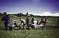 ASC Leiden - Rietveld Collection - East Africa 1975 - 05 - 032 - On the shore of a lake, soup of freshly caught fish is cooked and eaten by a company of men and women - Zambia or Zimbabwe.jpg