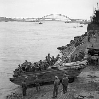 DUKW - A British DUKW carries American airborne troops and supplies across the River Waal at Nijmegen, 30 Sept. 1944
