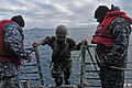 A Royal Moroccan Navy sailor, center, departs guided missile frigate USS Simpson (FFG 56) after a visit, board, search and seizure training session 120202-N-IZ292-167.jpg