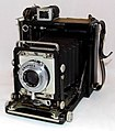 A Well-Used & Patched-Up Vintage Century Graphic Camera by Graflex, Introduced In 1949, Measures Approximately 5.75 Inches Wide, 6.75 Inches High & 3.25 Inches Deep, Made In USA (9108905498).jpg