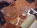 A glass of beer on a wooden table (2).jpg