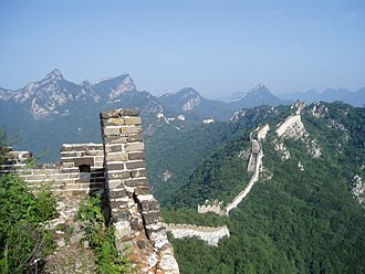 A more rural portion of the Great Wall that stretches through the mountains, here seen in slight disrepair A long stretch of the Great Wall.jpg