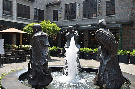 Xintiandi, now a high-end restaurant and shopping center A statue respresenting fortune, prosperity and longevity (36305081851).jpg
