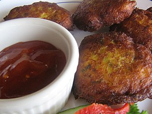Chili sauce - Fritters served with chili sauce in a ramekin