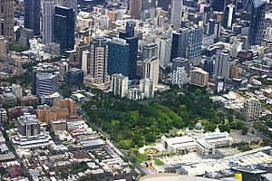 Aerial view of The Royal Exhibition Building in the Carlton Gardens and the Melbourne City Centre