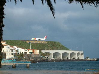 Santa Cruz, Madeira - Houses in Santa Cruz, with the arcades of the International Airport in the distance