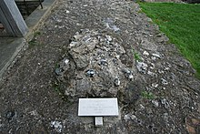 "Pile of stones marked with a tag reading ""St. Augustine, Site of Grave, First Archbishop of Canterbury"""