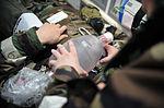 Airmen, Soldiers team up during dust-off, medevac 140212-F-FM358-151.jpg