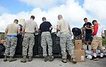 Airmen spread holiday cheer during Operation Christmas Drop sorting party 151204-F-IX728-032.jpg