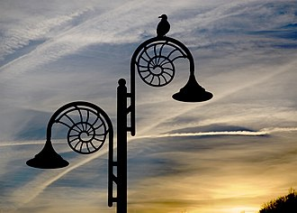 Street furniture - Street furniture can reflect local culture or famous aspects of where they are located, as here at Lyme Regis, where the ammonite-design streetlamps reflect the town's location on the Jurassic Coast, a World Heritage site.