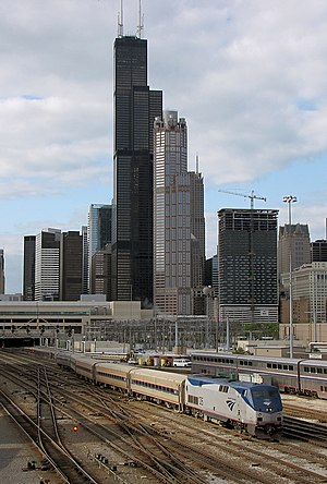 Lincoln Service - A Lincoln Service departs Chicago in May 2009. Directly behind is the Sears Tower (now Willis).