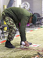An Afghan National Army (ANA) soldier with the 203rd Corps spray paints a sand table for a combined arms rehearsal at Forward Operating Base Thunder, Paktia province, Afghanistan, March 3, 2014 140303-A-IY570-125.jpg
