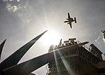 An E-2C Hawkeye flies over USS Carl Vinson. (33090722575).jpg