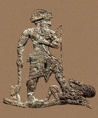 Lullubi - King Anubanini of Lullubi, holding an axe and a bow, trampling a foe. Anubanini rock relief, circa 2300-2000 BC. Sar-I Pul, Iran.