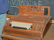 The Apple I, Apple's first product. Sold as an assembled circuit board, it lacked basic features such as a keyboard, monitor, and case. The owner of this unit added a keyboard and a wooden case.