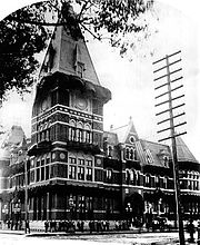 An ornate Victorian Gothic style building with a square tower