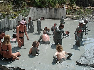 Mud bath Bath of mud, commonly from areas where hot spring water can combine with volcanic ash