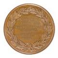 Baksida av medalj med bild av lagerkrans samt text - Skoklosters slott - 99312.tif