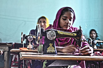 Sewing - Bangladeshi women sewing clothes.