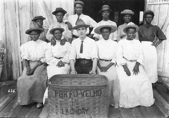 "Porto Velho - This photograph shows an American laundry boss and his ""Barbadian"" workers, a term used generally to refer to Caribbean immigrants. The laundry in Porto Velho had a steam press, regarded as something of a luxury at the time."