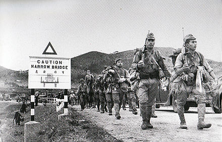 Japanese soldiers crossing the border from China into the British colony of Hong Kong during the Battle of Hong Kong in 1941 Battle of HK 01.jpg