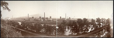 The Blast furnaces of Bethlehem Steel seen in a panoramic view from the north bank of the Lehigh River. South Mountain is in the distance. (c. 1896). Bethlehem steel c.1896.jpg