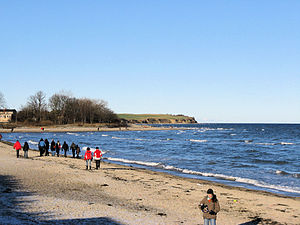 Boltenhagen -  Baltic sea beach and cliff coast (in the background)