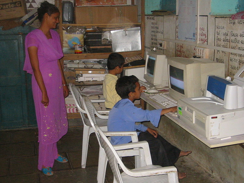 File:Boys teacher and computers Gujarat.jpg