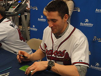 2012 Atlanta Braves season - Starting pitcher Brandon Beachy signing autographs at a 2012 Braves Country Caravan appearance.