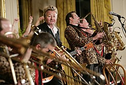 Brian Setzer performs with his orchestra in the East Room of the White House.jpg