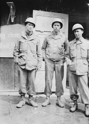 6th Armored Division (United States) - Three American soldiers from the 6th Armored Division pose in front of a building in the Buchenwald concentration camp. Pictured on the right is Sgt. Ezra Underhill (circa May 1945).