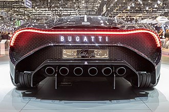 Bugatti Chiron - The Bugatti La Voiture Noire at the Geneva Motor Show. Note the six exhaust pipes at the rear of the car and the illuminated Bugatti lettering