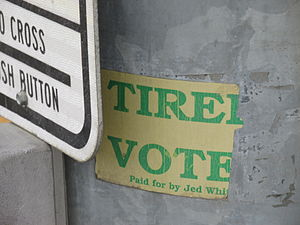 "United States Senate elections, 1996 - Remnant of Whittaker's campaign bumper sticker, photographed on a light pole on South Cushman Street in Fairbanks in 2014.  The bumper sticker read ""Tired of Ted?  Vote for Jed!""."