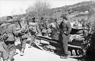 Albanian Kingdom (1943–44) - Albanian and German soldiers next to an Italian tank
